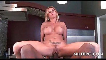 Dirty MILF shoves huge black dick in her cunt