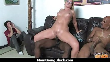 Mature MILF takes on big black cock 12