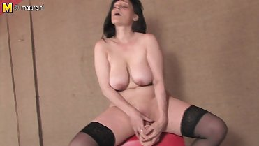 Hot mature mom playing with her dildo