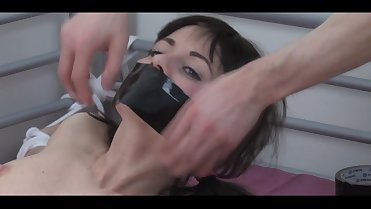 Tape Gagged & Spread Eagle Bondage
